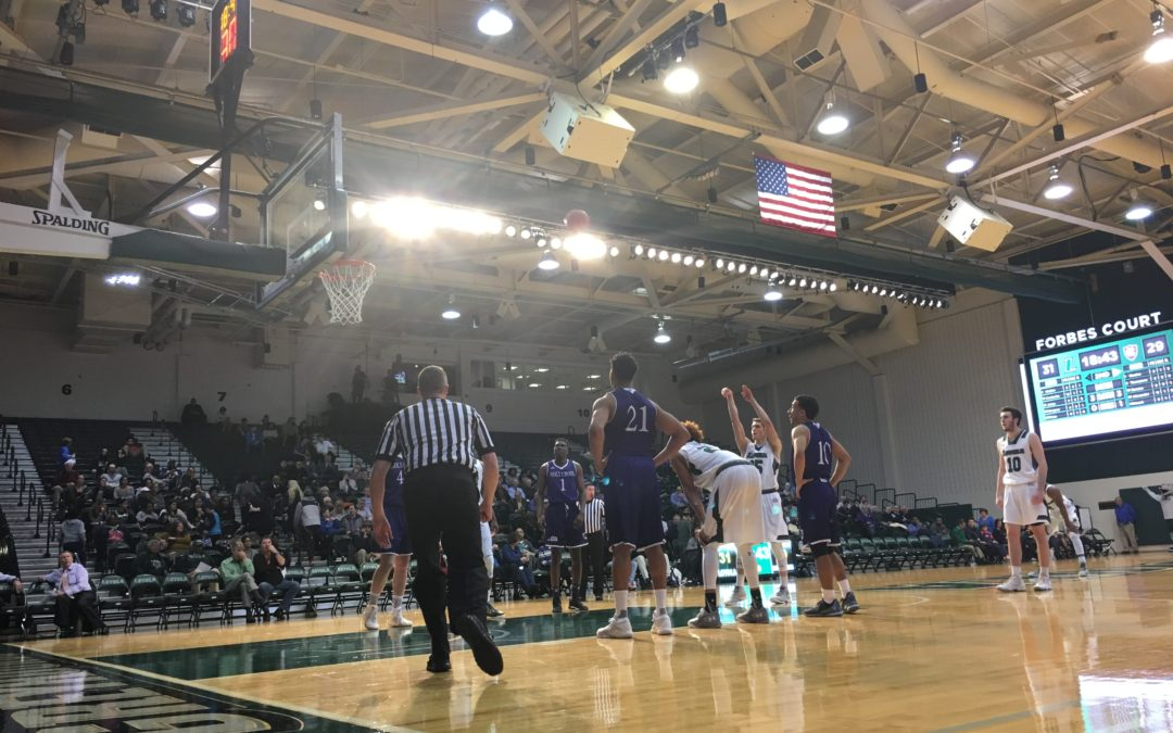 Loyola outlasts Holy Cross 65-62